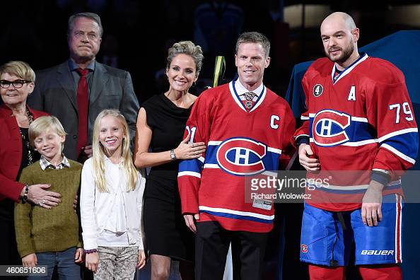 Former Montreal Canadien player Saku Koivu poses for a photo with family and former teammates during a ceremony honouring the former team captain...