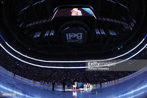 Former Montreal Canadien player Saku Koivu speaks to fans during a ceremony honouring the former team captain prior to the NHL game between the...