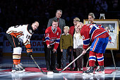 Former Montreal Canadien player Saku Koivu takes the ceremonial faceoff with former teammates Ryan Getzlaf of the Anaheim Ducks and Andrei Markov of...