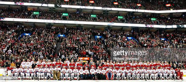 Former Montreal Canadiens players and current player sit for the official team photo during the Centennial Celebration ceremonies prior to the NHL...