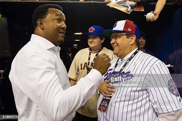 Former Montreal Expos pitcher Pedro Martinez chats with Montreal Mayor Denis Coderre during the MLB spring training game at Olympic Stadium on April...