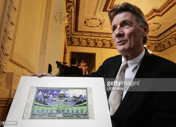 Former Monty Python actor and Oxford graduate Michael Palin holds an original artwork of JRR Tolkien's 'The Hobbit' as he attends the launch of the...