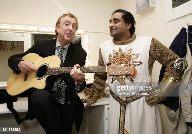 Former Monty Python star Eric Idle who wrote the book and lyrics to the show poses backstage with Sanjeev Bhaskar who plays King Arthur after paying...