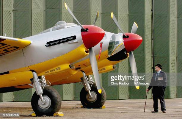 Former Mosquito pilot and Chairman of the Mosquito Aircrew Association Eric Atkins from Surrey surveys the de Havilland Mosquito aircraft after a...
