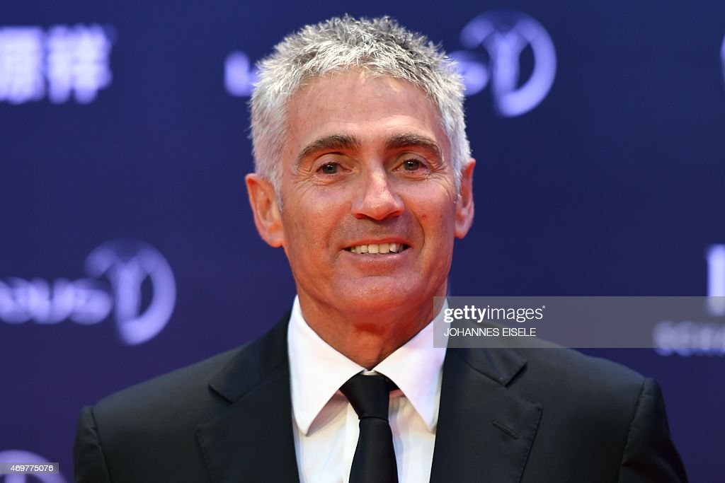 Former MotoGP driver <a gi-track='captionPersonalityLinkClicked' href=/galleries/search?phrase=Mick+Doohan&family=editorial&specificpeople=604096 ng-click='$event.stopPropagation()'>Mick Doohan</a> poses on the red carpet as he arrives ahead of the Laureus World Sports Award ceremony at the Grand Theater in Shanghai on April 15, 2015. The holding of the awards ceremony in the commercial hub of Shanghai comes as Beijing bids for the 2022 Winter Olympics, amid rumours that China could even seek to host the 2026 football World Cup.