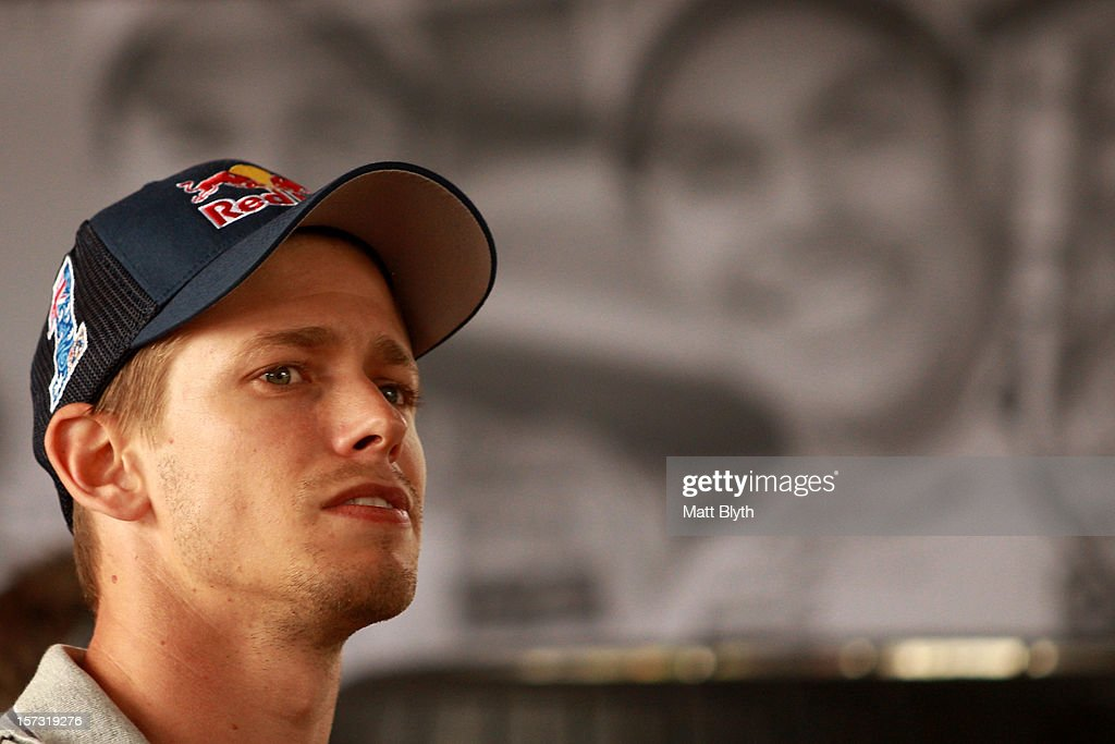 Former MotoGP world champion and rider Casey Stoner watches the broadcast in the Team Vodafone Holden pit garage during the Sydney 500, which is round 15 of the V8 Supercars Championship Series at Sydney Olympic Park Street Circuit on December 2, 2012 in Sydney, Australia.