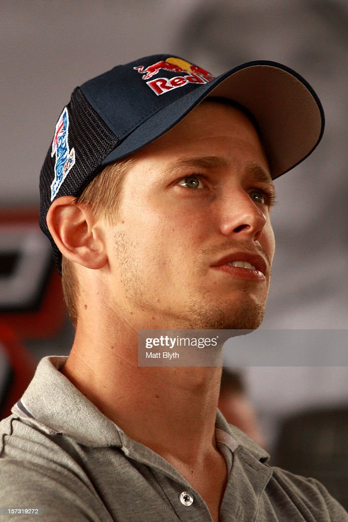 Former MotoGP world champion <a gi-track='captionPersonalityLinkClicked' href=/galleries/search?phrase=Casey+Stoner&family=editorial&specificpeople=563465 ng-click='$event.stopPropagation()'>Casey Stoner</a> watches the broadcast in the Team Vodafone Holden pit garage during the Sydney 500, which is round 15 of the V8 Supercars Championship Series at Sydney Olympic Park Street Circuit on December 2, 2012 in Sydney, Australia.