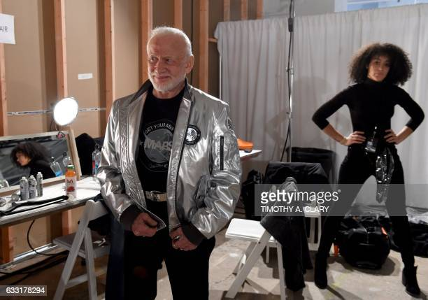 Former NASA astronaut Buzz Aldrin lunar module pilot on Apollo 11 and second man to walk on the Moon waits backstage during the Nick Graham fashion...