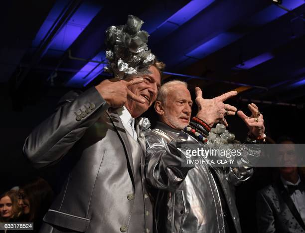 Former NASA astronaut Buzz Aldrin lunar module pilot on Apollo 11 and second man to walk on the Moon poses with Nick Graham after Walking the runway...