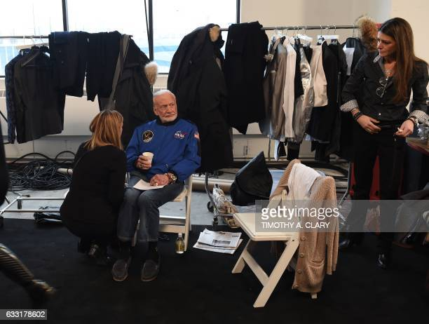 Former NASA astronaut Buzz Aldrin lunar module pilot on Apollo 11 and second man to walk on the Moon sits backstage before walking the runway during...