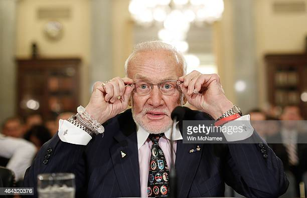 Former NASA astronaut Buzz Aldrin prepares to testify before the Senate Space Science and Competitiveness Subcommittee on Capitol Hill February 24...