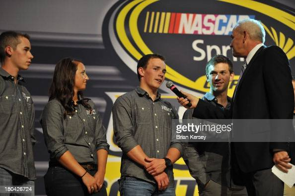 Former NASCAR driver and commentator Dale Jarrett asks a question to NASCAR Next driver Ryan Moffitt as he stands on stage with fellow drivers Ben...