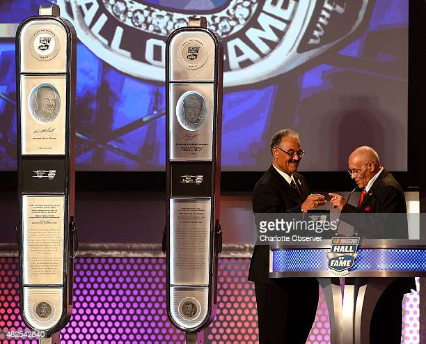 Former NASCAR driver Wendell Scott's son Franklin Scott hands his father's Hall of Fame ring to his brother Wendell Scott Jr right during the NASCAR...