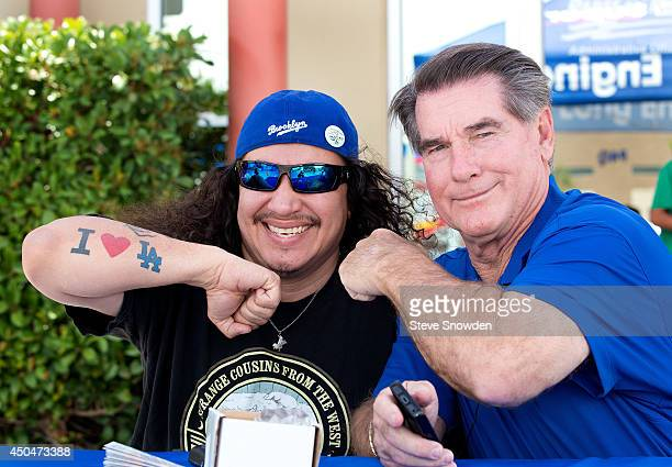 Former National League MVP and 10time AllStar Steve Garvey compares forearms with a fan during a stop of the 2014 Mobil Super Go the Distance...