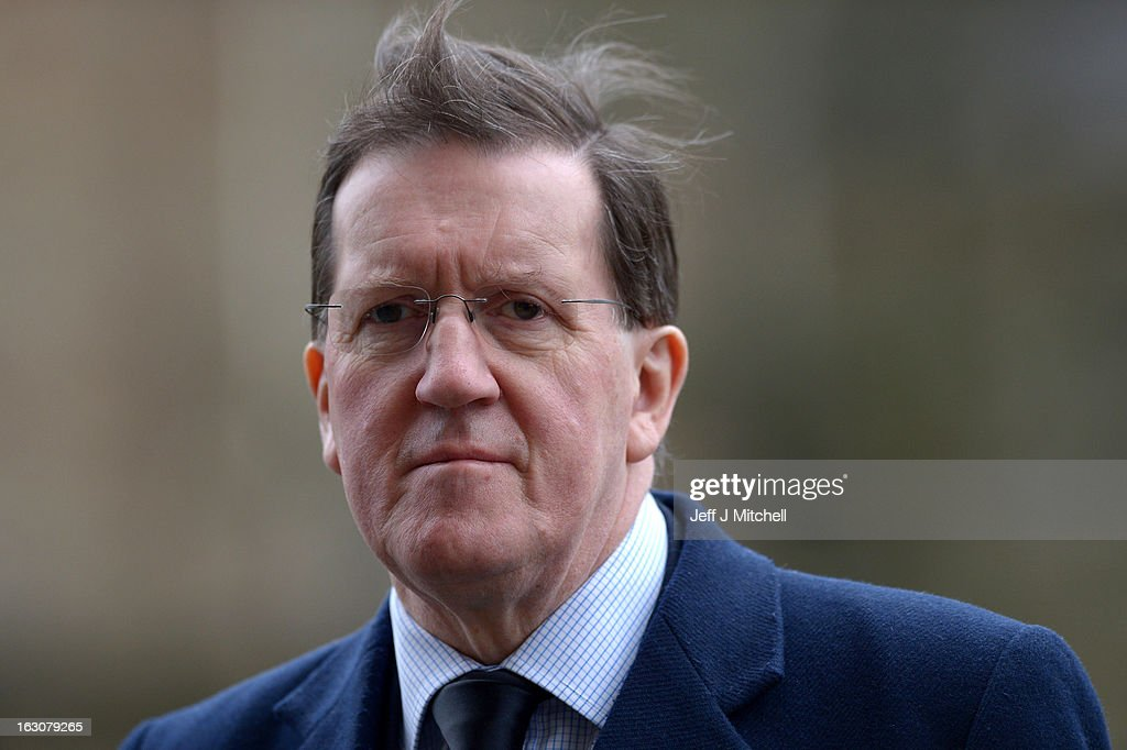 Former NATO Secretary General Lord <a gi-track='captionPersonalityLinkClicked' href=/galleries/search?phrase=George+Robertson&family=editorial&specificpeople=158921 ng-click='$event.stopPropagation()'>George Robertson</a> attends the memorial service of former Scottish Secretary and European Commissioner Bruce Millan at Govan Parish Church on March 4, 2013 in Glasgow, Scotland. Bruce Millan died on February 21, aged 85, after having been recently diagnosed with cancer.