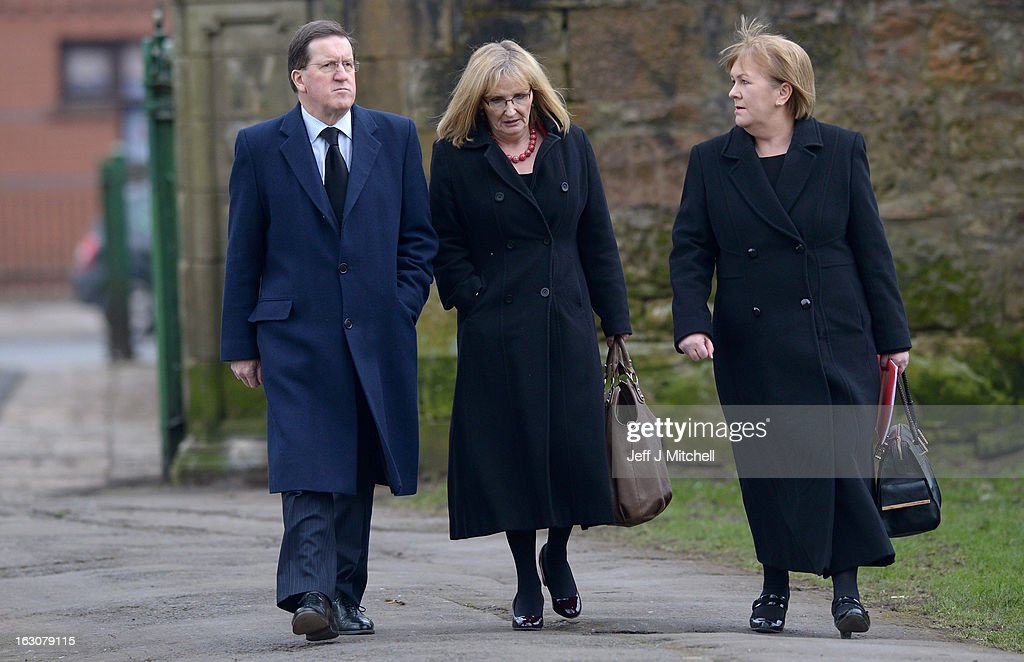 Former NATO Secretary General Lord <a gi-track='captionPersonalityLinkClicked' href=/galleries/search?phrase=George+Robertson&family=editorial&specificpeople=158921 ng-click='$event.stopPropagation()'>George Robertson</a> (L), Scottish Labour leader Johann Lamont (R) and Shadow Secretary of State for Scotland Margaret Curran (C) attend the memorial service of former Scottish Secretary and European Commissioner Bruce Millan at Govan Parish Church on March 4, 2013 in Glasgow, Scotland. Bruce Millan died on February 21, aged 85, after having been recently diagnosed with cancer. (Photo by Jeff J Mitchell/Getty Images))