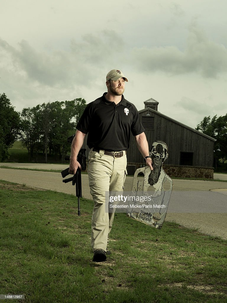 Former Navy SEAL and expert sniper, <a gi-track='captionPersonalityLinkClicked' href=/galleries/search?phrase=Chris+Kyle&family=editorial&specificpeople=2349756 ng-click='$event.stopPropagation()'>Chris Kyle</a>, is photographed on his ranch for Paris Match magazine on April 2, 2012 in Dallas, Texas. In this picture, Chris, gun drawn, prepares for a shooting session.