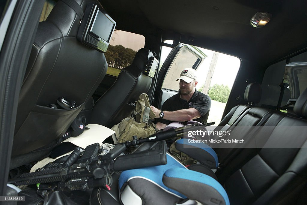 Former Navy SEAL and expert sniper, <a gi-track='captionPersonalityLinkClicked' href=/galleries/search?phrase=Chris+Kyle&family=editorial&specificpeople=2349756 ng-click='$event.stopPropagation()'>Chris Kyle</a>, is photographed on his ranch for Paris Match magazine on April 2, 2012 in Dallas, Texas. In this picture, Chris is organizing his weapons and military gear in the back of his vehicle.