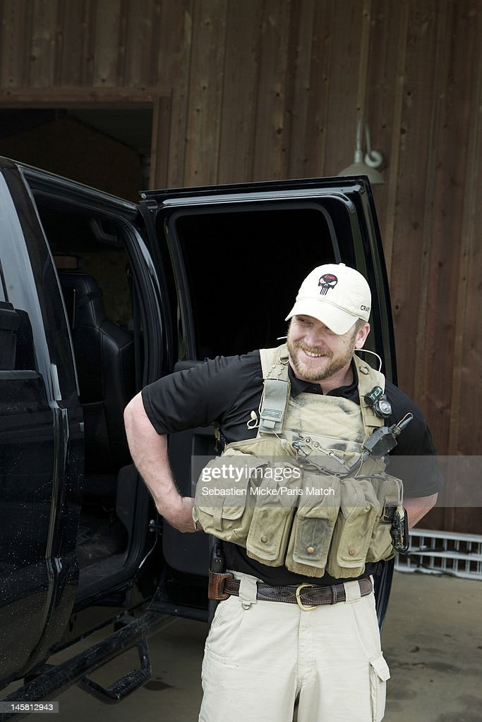 Former Navy SEAL and expert sniper, <a gi-track='captionPersonalityLinkClicked' href=/galleries/search?phrase=Chris+Kyle&family=editorial&specificpeople=2349756 ng-click='$event.stopPropagation()'>Chris Kyle</a>, is photographed wearing some of his military equipment on his ranch for Paris Match magazine on April 2, 2012 in Dallas, Texas.