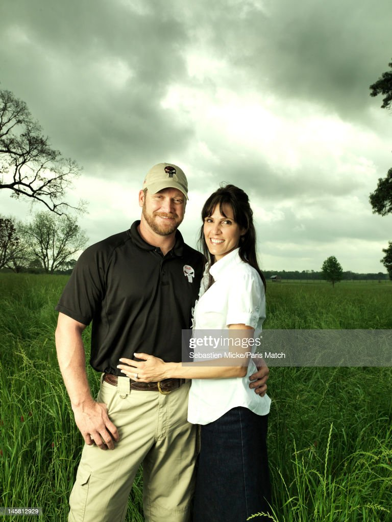 Former Navy SEAL and expert sniper, <a gi-track='captionPersonalityLinkClicked' href=/galleries/search?phrase=Chris+Kyle&family=editorial&specificpeople=2349756 ng-click='$event.stopPropagation()'>Chris Kyle</a>, standing with his wife Taya, are photographed on their ranch for Paris Match magazine on April 2, 2012 in Dallas, Texas.