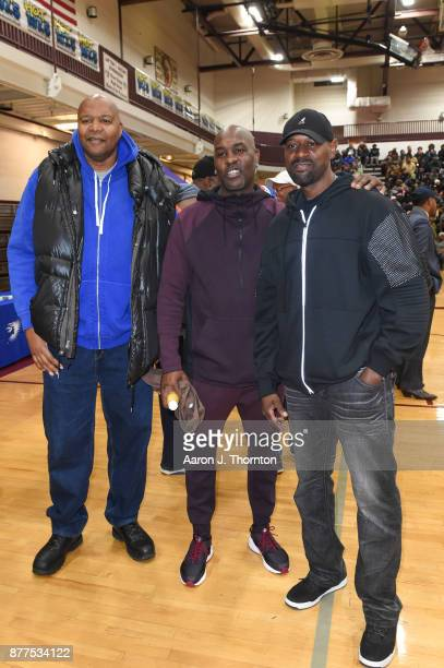 Former NBA and NFL athletes Derrick Coleman Gary Payton and Herman Moore attend the 2017 Annual AllStar Giveback Thanksgiving Edition on November 21...