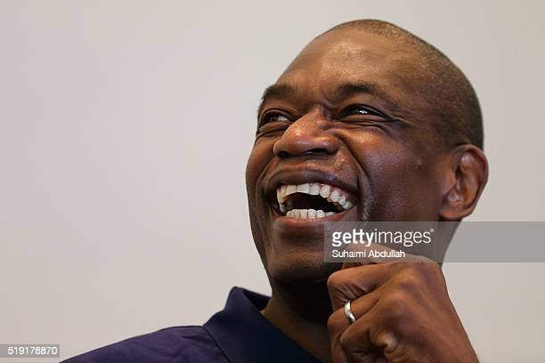 Former NBA basketball player Dikembe Mutombo speaks to the media at Marina Bay Sands on April 5 2016 in Singapore Mutombo is a member of the recently...