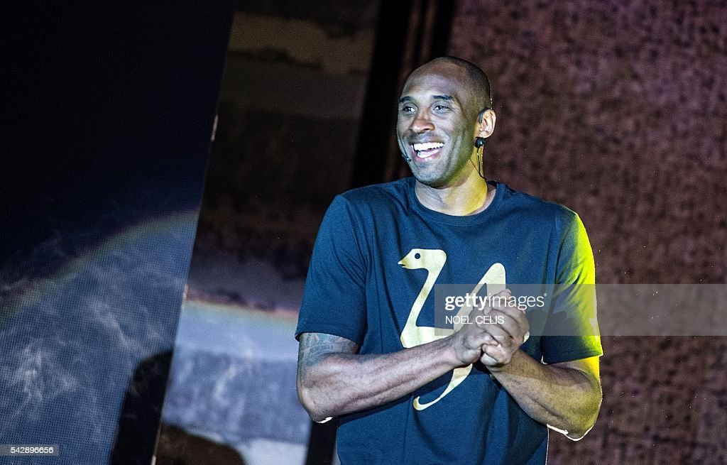 Former NBA basketball player Kobe Bryant gestures as he is introduced to the media and fans during a public appearance in Manila on June 25, 2016. / AFP / NOEL