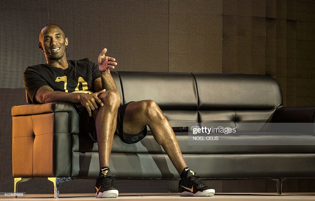 Former NBA basketball player Kobe Bryant gestures as he speaks during a public appearance in Manila on June 25, 2016. / AFP / NOEL
