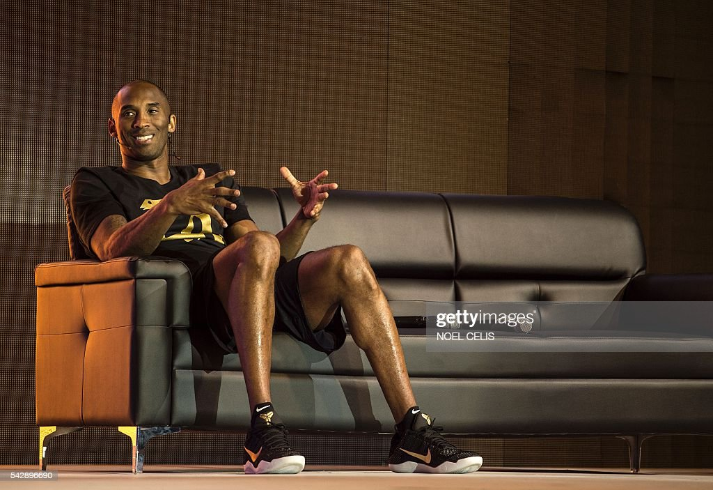 Former NBA basketball player Kobe Bryant gestures during a public appearance in Manila on June 25, 2016. / AFP / NOEL