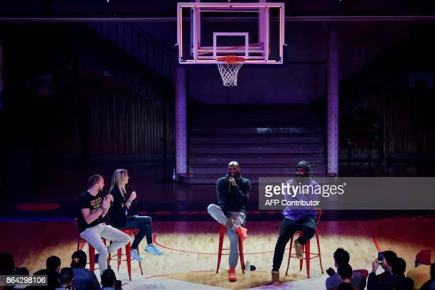 Former NBA basketball player Kobe Bryant speaks as former FRench power forward Ronny Turiaf looks on during a promotional event organized by the...