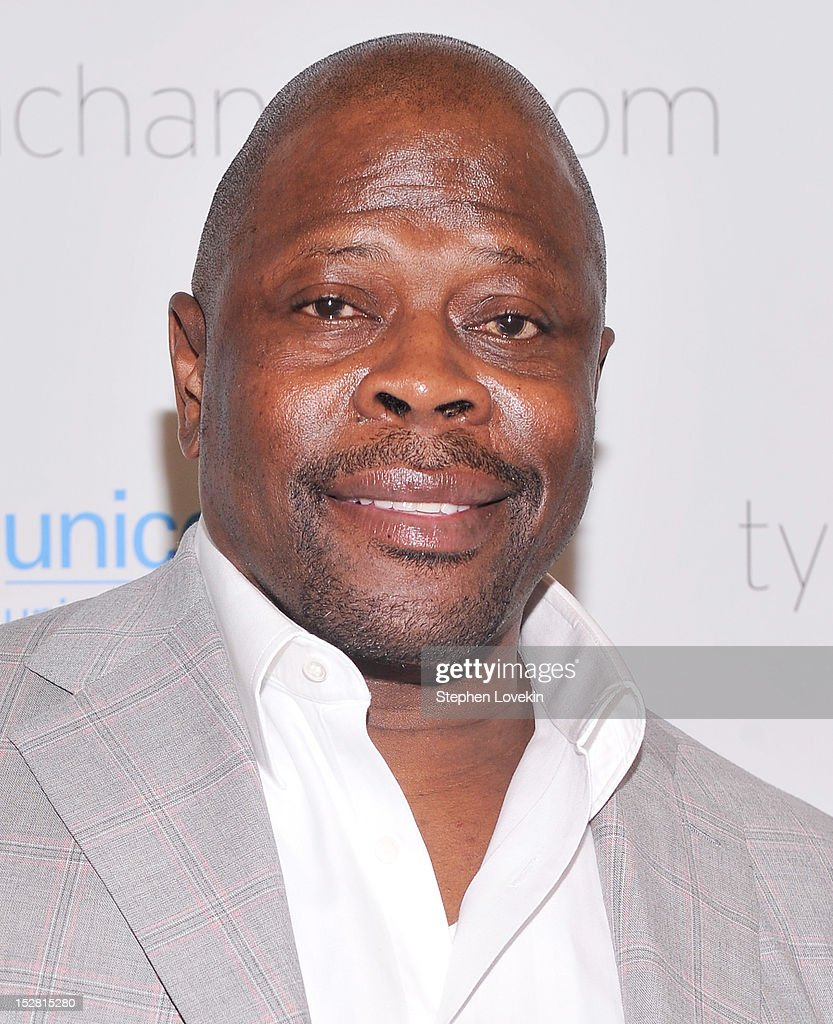 Former NBA basketball player <a gi-track='captionPersonalityLinkClicked' href=/galleries/search?phrase=Patrick+Ewing&family=editorial&specificpeople=202881 ng-click='$event.stopPropagation()'>Patrick Ewing</a> attends the 'A Year In A New York Minute' photo exhibition at Canoe Studios on September 26, 2012 in New York City.