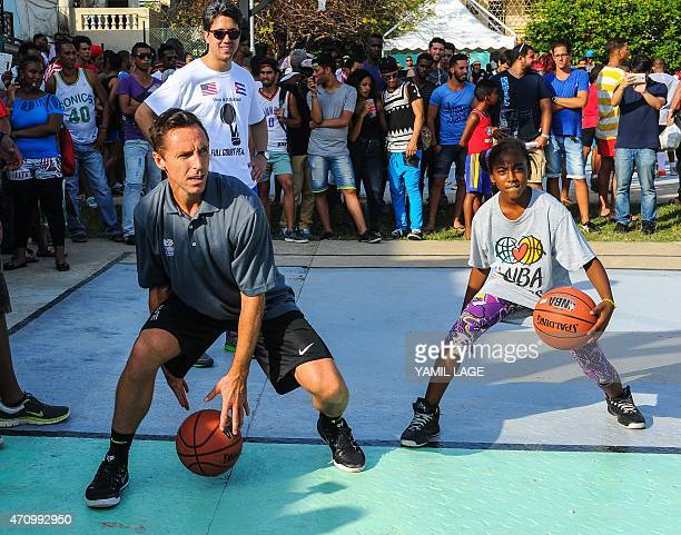 Former NBA basketball player Steve Nash gives instructions to Cuban children during clinical organized by the NBA FIBA Americas and Cuban Basketball...