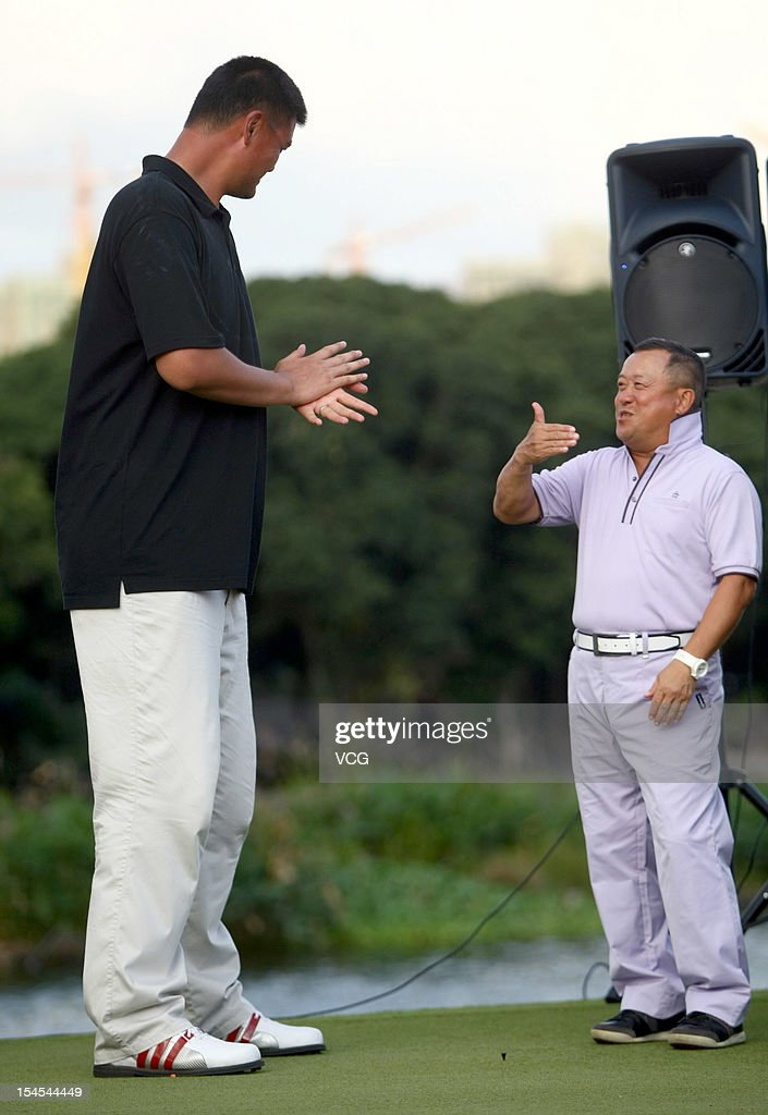 Former NBA basketball player <a gi-track='captionPersonalityLinkClicked' href=/galleries/search?phrase=Yao+Ming&family=editorial&specificpeople=201476 ng-click='$event.stopPropagation()'>Yao Ming</a> talks with Hong Kong actor Eric Tsang Chi-wai (R) during day four of the Mission Hills Star Trophy at the Mission Hills Golf Club on October 21, 2012 in Haikou, China.