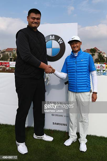 Former NBA basketballer Yao Ming and Haotong Li of China shake hands on the first tee prior to the start of the BMW Masters at Lake Malaren Golf Club...