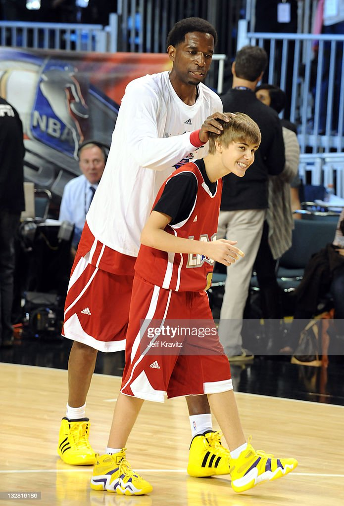 Former NBA Player AC Green and Singer Justin Bieber during the 2011 BBVA NBA AllStar Celebrity Game at Los Angeles Convention Center on February 18...
