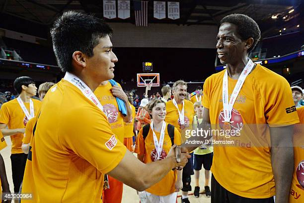 Former NBA player AC Green shakes hands after playing in the Celebrity Game during the Special Olympics World Games at the Galen Center at University...