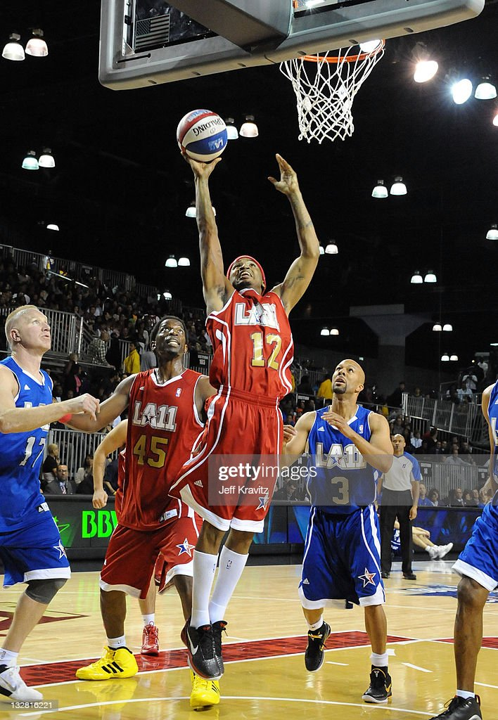 Former NBA Player AC Green Singer Trey Songz and Singer Common during the 2011 BBVA NBA AllStar Celebrity Game at Los Angeles Convention Center on...