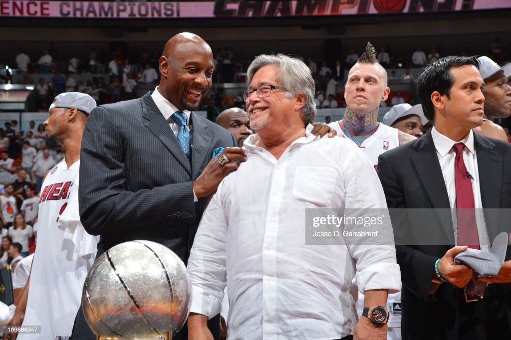 Former NBA player Alonzo Mourning and Micky Arison owner of the Miami Heat share a laugh after Game Seven of the Eastern Conference Finals against...