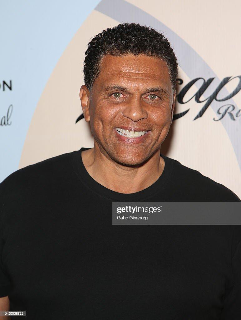 Reggie Theus s – of Reggie Theus