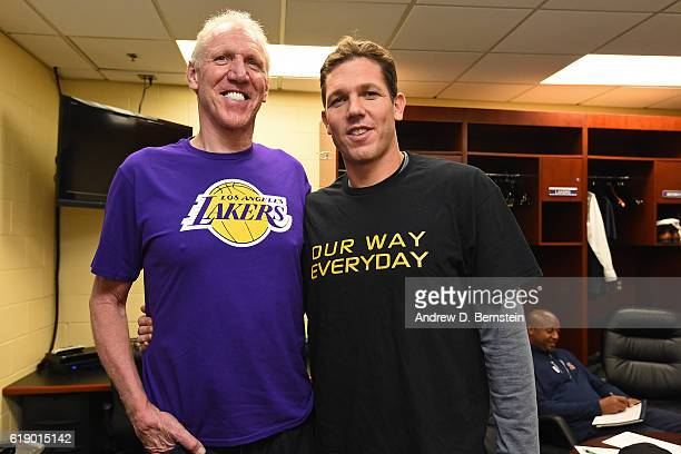 Former NBA player Bill Walton and Luke Walton of the Los Angeles Lakers pose for a photo before the game against the Houston Rockets on October 26...