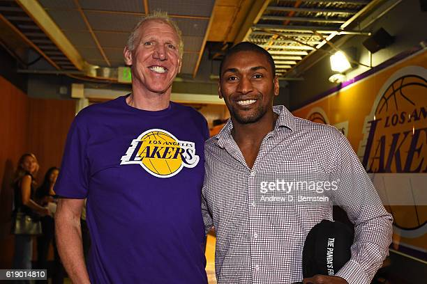 Former NBA player Bill Walton and Metta World Peace of the Los Angeles Lakers pose for a photo before the game against the Houston Rockets on October...