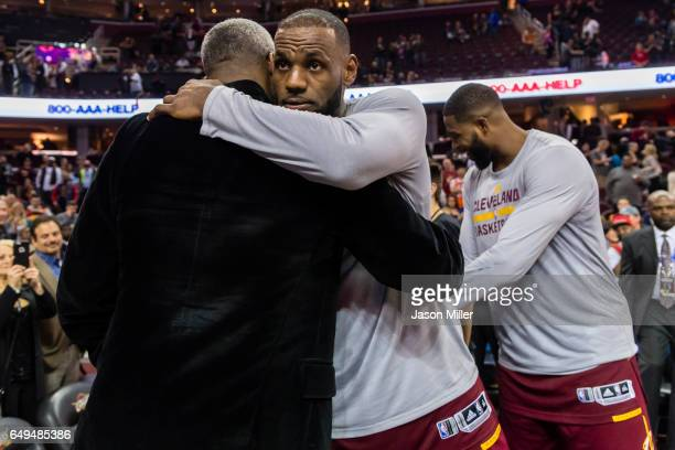Former NBA player Charles Oakley embraces LeBron James of the Cleveland Cavaliers after the game against the New York Knicks at Quicken Loans Arena...