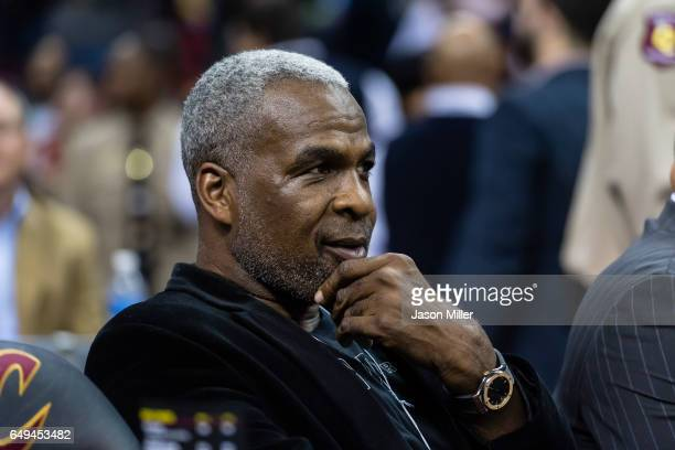 Former NBA player Charles Oakley sits court side prior to the game between the Cleveland Cavaliers and the New York Knicks at Quicken Loans Arena on...