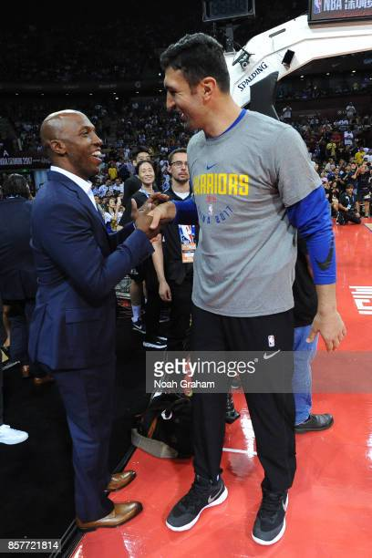 Former NBA player Chauncey Billups greets Zaza Pachulia of the Golden State Warriors before the game against the Minnesota Timberwolves as part of...