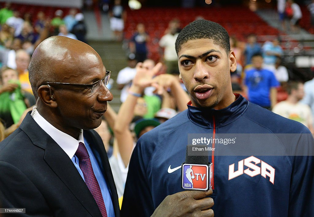 Former NBA player Clyde Drexler (L) interviews Anthony Davis #42 of the 2013 USA Basketball Men's National Team after a USA Basketball showcase at the Thomas & Mack Center on July 25, 2013 in Las Vegas, Nevada.