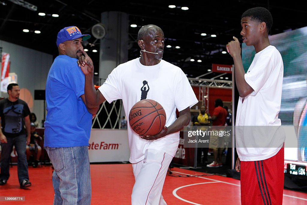 Former NBA player Craig Hodges, coaches fans from the audience into players during a clinic on the State Farm court at Jam Session during All Star Weekend on February 26, 2012 in Orlando, Florida.