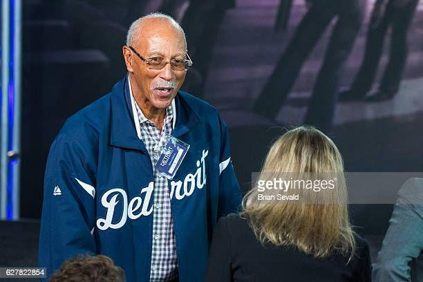 Former NBA player Dave Bing shakes hands during a press conference to announce that the Detroit Pistons will move to downtown Detroit and begin...