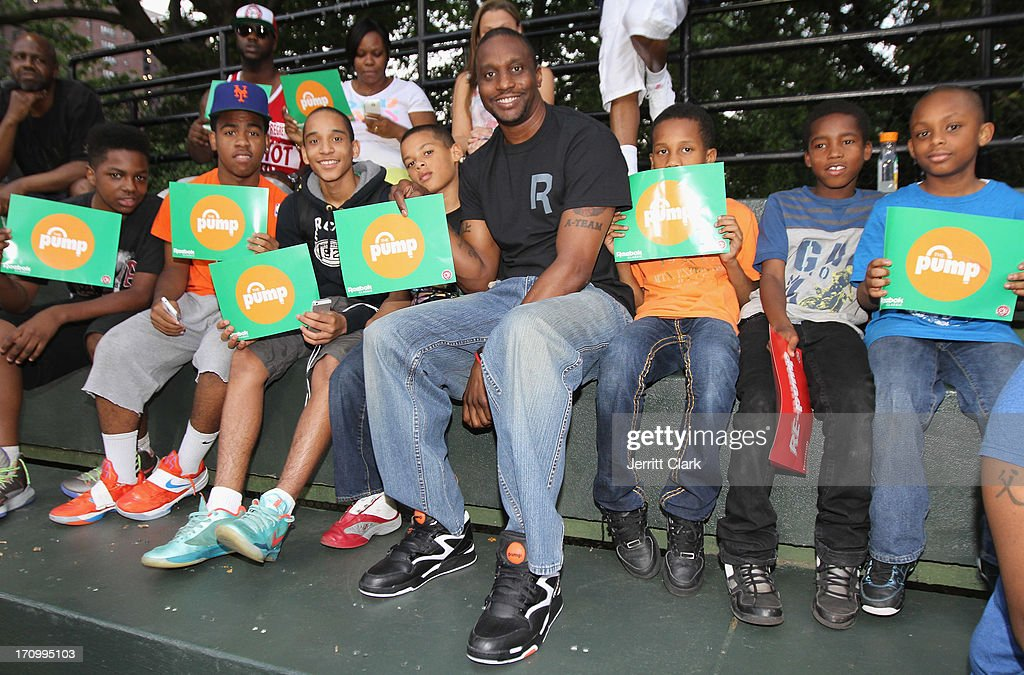 Former NBA Player Dee Brown poses with fans during the Reebok Classic Pump Omni Lite Dunk Contest at EBC at Rucker Park on June 20, 2013 in New York City.