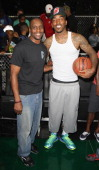 Former NBA Player Dee Brown poses with NBA player JR Smith at the Reebok Classic Pump Omni Lite Dunk Contest at EBC at Rucker Park on June 20 2013 in...