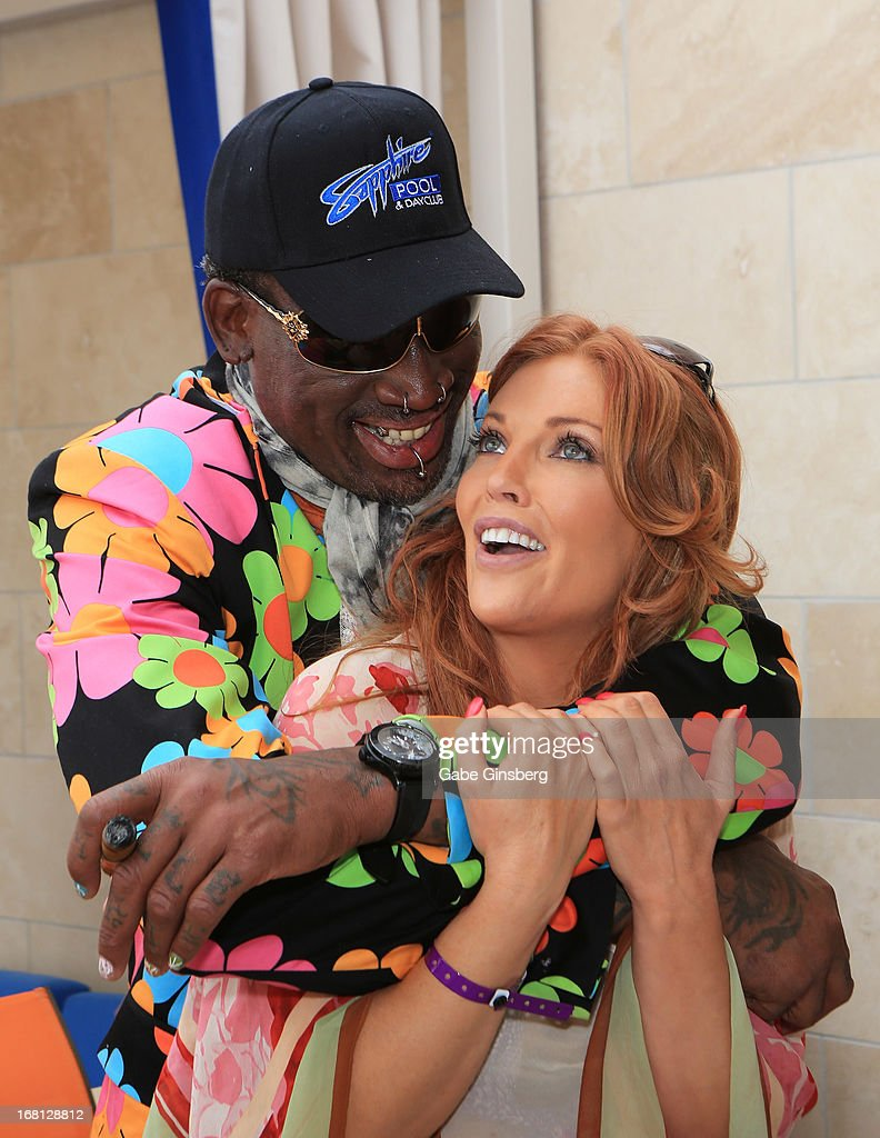 Former NBA player <a gi-track='captionPersonalityLinkClicked' href=/galleries/search?phrase=Dennis+Rodman&family=editorial&specificpeople=202643 ng-click='$event.stopPropagation()'>Dennis Rodman</a> (L) hugs model/actress <a gi-track='captionPersonalityLinkClicked' href=/galleries/search?phrase=Angelica+Bridges&family=editorial&specificpeople=677753 ng-click='$event.stopPropagation()'>Angelica Bridges</a> at the Sapphire Pool & Day Club grand opening party on May 5, 2013 in Las Vegas, Nevada.